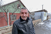 A man smiles as he poses and walks in street nearby residential area where the Rubble left by the Spitak Earthquake which struck 33 years ago are still visible. On Sunday, Jan 16, 2021, I visited the city which lies close to the epicentre of 1988 devastating Armenia quake, some 100 km (62 miles) north of the capital Yerevan. Spitak was entirely destroyed during the devastating earthquake, which is now rebuilt in a slightly different location. The earthquake that devastated Armenia in December 1988 killed 25,000 people and leaving half a million homeless. Like the tsunami that devastated southern Asia 16 years later, it focused the world's sympathy for unspeakable suffering and unleashed an outpouring of aid. (Photo/ Vudi Xhymshiti)