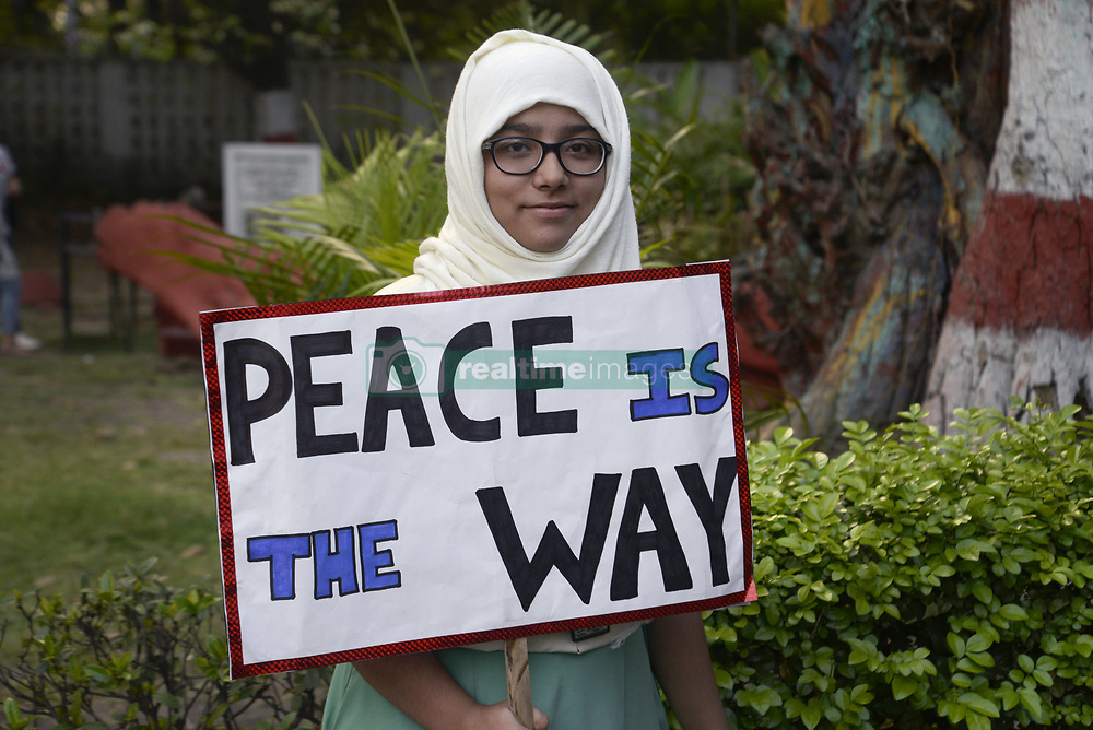 April 17, 2018 - Kolkata, West Bengal, India - Muslim girl hold poster against rape during the candle light march. People of different community participate in a candle light march against growing numbers of rape. (Credit Image: © Saikat Paul/Pacific Press via ZUMA Wire)