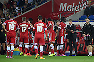 Cardiff city manager Ole Gunnar Solksjaer ® looks on at his players during a break in play. Skybet football league championship match, Cardiff city v Middlesbrough at the Cardiff city stadium in Cardiff, South Wales on Tuesday 16th Sept 2014<br /> pic by Andrew Orchard, Andrew Orchard sports photography.