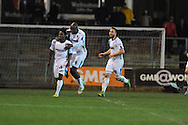 Wimbledon 's Kevin Sainte-Luce (l) celebrates after he scores his sides 2nd goal.  Skybet football league 2 match, Newport county v AFC Wimbledon  at Rodney Parade in Newport, South Wales on Tuesday 25th Feb 2014.<br /> pic by Andrew Orchard, Andrew Orchard sports photography.