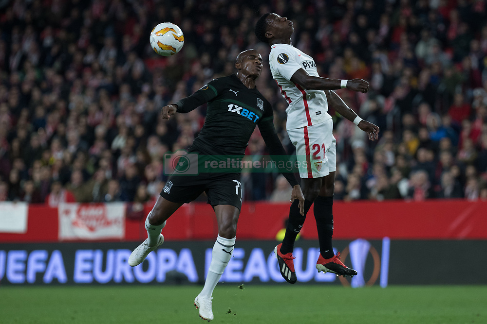December 13, 2018 - Seville, Andalucia, Spain - Promes of Sevilla FC and Kabore of Krasnodar fight for the ball during the Europa League match between Sevilla FC and Krasnodar in Ramón Sánchez Pizjuán Stadium (Seville) (Credit Image: © Javier MontañO/Pacific Press via ZUMA Wire)