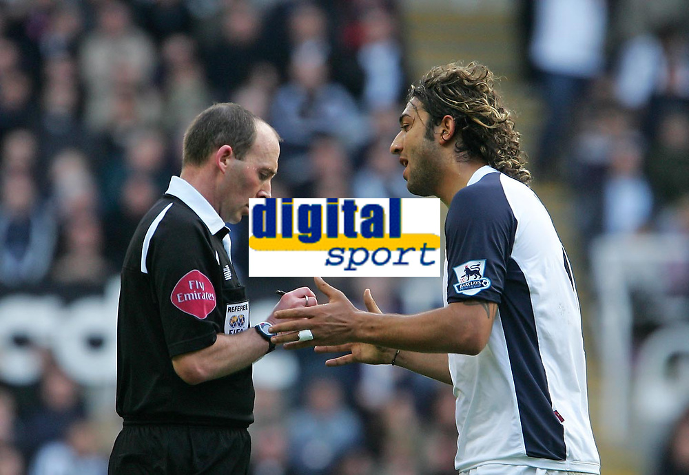 Photo: Andrew Unwin.<br />Newcastle United v Tottenham Hotspur. The Barclays Premiership. 01/04/2006.<br />Tottenham's Mido (R) is booked by the referee, Mike Dean (L), for dissent.