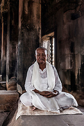 Aug. 2, 2013 - Senior buddhist monk meditating in temple in Angkor Wat, Siem Reap, Cambodia (Credit Image: © Gary  Latham/Cultura/ZUMAPRESS.com)