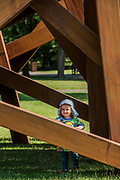 Orli, aged 2, enjoys playing in Bernar Venet's 11 Acute Unequal Angles (2016) - The Frieze Sculpture Park 2017 comprises large-scale works, set in the English Gardens . The installations will remain on view until 8 Oct 2017.