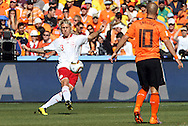 14 JUN 2010:  Simon Kjaer (DEN)(3) sends the ball down field as Wesley Sneijder (NED)(10) looks on.  The Netherlands National Team defeated the Denmark National Team 2-0 at Soccer City Stadium in Johannesburg, South Africa in a 2010 FIFA World Cup Group E match.