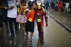 August 9, 2017 - Kathmandu, Nepal - A person dressed as a superhero take part in a parade during Ropai festival to commemorate the departed in Kathmandu, Nepal on Wednesday, August 09, 2017. (Credit Image: © Skanda Gautam via ZUMA Wire)