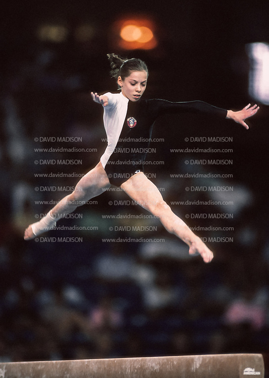 SEATTLE - JULY 1990:  Tatiana Lysenko of the USSR competes in the balance beam event of the gymnastics competition of the 1990 Goodwill Games held from July 20 - August 5, 1990.  The gymnastics venue was the Tacoma Dome in Tacoma, Washington.  (Photo by David Madison/Getty Images)