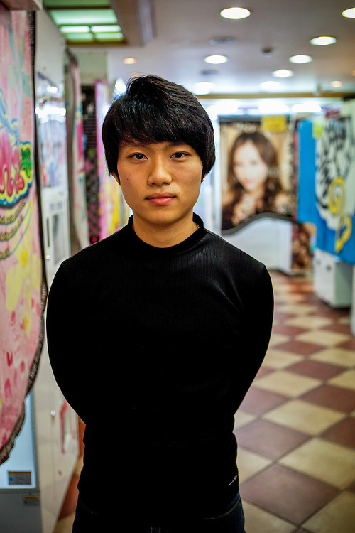 Portrait of a young man working in a kind of photo factory in the city of Daegu, South Korea.