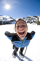 Young woman snowshoeing near Lake Tahoe, CA