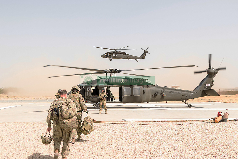 May 31, 2017 - Kunduz, Afghanistan - A U.S. Army UH-60 Black Hawk helicopter crew chief assigned to Task Force Griffin, 16th Combat Aviation Brigade, directs passengers during loading May 31, 2017 in Kunduz, Afghanistan. Kunduz has seen increased Taliban activity as more than 8,000 American troops and 6,000 from NATO and allied countries continue to assist the government. (Credit Image: © Brian Harris/Planet Pix via ZUMA Wire)