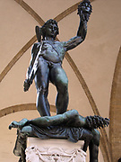 Bronze statue of Perseus holding the severed head of Medusa. Perseus stands naked triumphantly atop her blood spewing body. Made by Benvenuto Cellini circa 1545 AD, and currently sits in the Piazza della Signoria, Florence, Italy.
