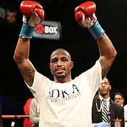 Super Middleweight fighter J'Leon Love (red) celebrates after defeating Vladine Biosse during Showtime Televisions ShoBox:The Next Generation boxing match at the Event Center at Turning Stone Resort Casino on Friday, February 28, 2014 in Verona, New York.  (AP Photo/Alex Menendez)