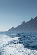 Waves on sea and mountain on background, Port de Girolata, Scandola Nature Reserve, Corsica, France