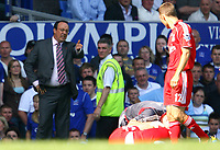 Fotball<br /> England<br /> Foto: Propaganda/Digitalsport<br /> NORWAY ONLY<br /> <br /> 09.08.2006<br /> Everton v Liverpool<br /> Liverpool's manager Rafael Benitez  looks annoyed as John Arne Riise lies injured against Everton during the 204th Merseyside Derby match at Goodison Park
