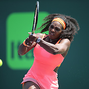 Serena Williams of the United States returns a ball to Svetlana Kuznetsova of Russia during their match at the Miami Open tennis tournament at Crandon Park on Monday, March 30, 2015 in Key Biscayne, Florida. Williams won the match 6-2, 6-3. (AP Photo/Alex Menendez)
