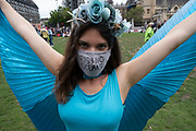 Extinction Rebellion activist with blue wings and a face mask which reads 'rising oceans' at the Marine Rebellion march on 6th September 2020 in London, United Kingdom. Ocean Rebellion, Sea Life Extinction, Animal Rebellion and Extinction Rebellion joined together to celebrate the biodiversity found in our seas, and to grieve at the destruction of the Earth's oceans and marine life due to climate breakdown and human interference, and the loss of lives, homes and livelihoods from rising sea levels. Extinction Rebellion is a climate change group started in 2018 and has gained a huge following of people committed to peaceful protests. These protests are highlighting that the government is not doing enough to avoid catastrophic climate change and to demand the government take radical action to save the planet.