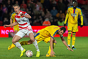 Doncaster Rovers midfielder Tommy Rowe (10) tackles Crystal Palace midfielder Luka Milivojevic (4) during the The FA Cup 5th round match between Doncaster Rovers and Crystal Palace at the Keepmoat Stadium, Doncaster, England on 17 February 2019.