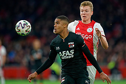 Perr Schuurs #2 of Ajax and Myron Boadu #9 of AZ Alkmaar in action during the Dutch Eredivisie match round 25 between Ajax Amsterdam and AZ Alkmaar at the Johan Cruijff Arena on March 01, 2020 in Amsterdam, Netherlands