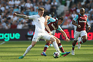 Alfie Mawson of Swansea City (L) tackling Jonathan Calleri of West Ham United (R). Premier league match, West Ham Utd v Swansea city at the London Stadium, Queen Elizabeth Olympic Park in London on Saturday 8th April 2017.<br /> pic by Steffan Bowen, Andrew Orchard sports photography.