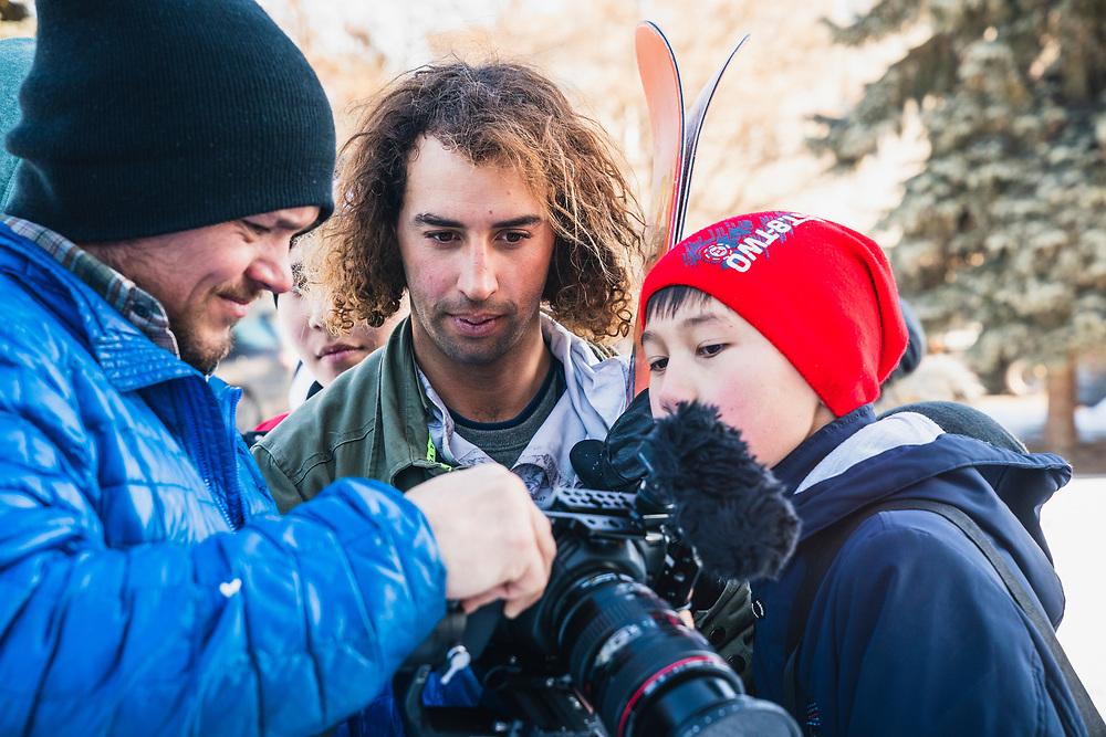 Ahmet Dadali and curious kid review footage on the streets of Karakol, KG..