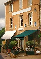 Brick building with awnings, Montparnasse, Paris France