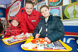 The Kingsmill Big Lunch Tour reaches Sheffield and puts the fun back into lunchtimes  in Fargate Sheffield on Wednesdayas Mark Laws of Kingsmill helps Bronson Watson (left) and Jenson Harrison (right) with thier Sandwich making...http://www.pauldaviddrabble.co.uk.11 April 2012 .Image © Paul David Drabble