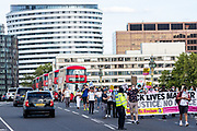"People holding a ""Black Lives Matter"" banner, march along the Nurses as well as care workers from St Thomas' Hospital through Westminster Bridge in Central London to support a protest for a pay rise on Wednesday, July 29, 2020. Health care unions are launching a campaign for a pay rise for NHS (National Health Service) nurses and care workers. NHS demonstration was also supported by the Black Lives Matter activists. (VXP Photo/ Vudi Xhymshiti)"