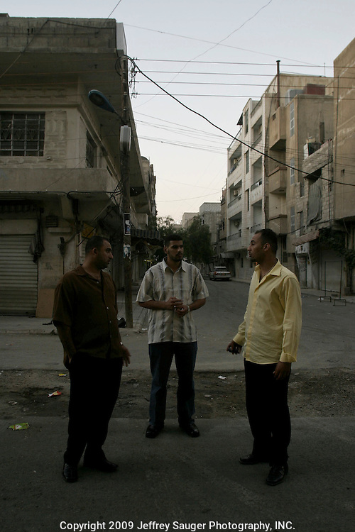 Haider Al-Jubury, left, Ahmad Al-Hamedi, center, and Emad Al-kasid, right, decide where to eat breakfast as the sun rises in the Iraqi area of Damascus, Syria, Saturday, July 12, 2003. Al-Jubury and Emad Al-kasid have been been planning the trip home to Iraq, over the last year. They are visiting their immediate families in Damascus, Syria, as hundreds of thousands of Iraqi Shiite settled in Syria after the Gulf War and their uprising against Saddam Hussein in 1991.
