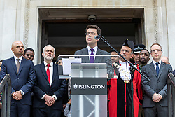 © Licensed to London News Pictures. 19/06/2018. London, UK. Secretary of State for Housing, Communities and Local Government James Brokenshire (centre) joins politicians, community and faith leaders, and members of Islington Council for a minute's silence on the steps of Islington Town Hall to mark the first anniversary of the Finsbury Park Attack. Photo credit: Rob Pinney/LNP