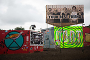 Art work by Dr D. and others at Shangri-la at the Glastonbury Festival 22th July 2016, Somerset, United Kingdom. Shangri-la is a venue at the festival with  art and politics mixed with tunes and all night club nights. Work getting the festival ready takes weeks and in the days up to the festival starts work is frantic.  The Glastonbury Festival runs over 3 days and has 3000 acts, including music, art and performance and approx. 150.000 attend the anual event.