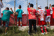 "Comercial FC Fans anxiously support their  amateur  football club's bid for the local state championship in a suburb of Sao Paulo city. ""Varzea"" is the impassioned  amateur game supported by local businesses usually in poor neighbourhoods  of Brazil's large and small cities, 2013."
