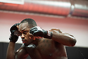UFC middleweight Derek Brunson of North Carolina shadow boxes between sparing rounds at Jackson Wink MMA in Albuquerque, New Mexico on June 9, 2016.