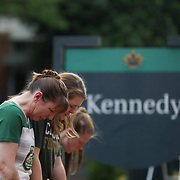 CHARLOTTE NC - MAY 1: Students and faculty neal to pray at  the steps of Kennedy Hall to honor the victims of a shooting the day earlier on the University of North Carolina Charlotte campus in University City, Charlotte, NC on April 30, 2019.  (Logan Cyrus for AFP)