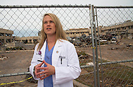 """Stephanie Barnhart, the """"heroine doc"""" head of ER at the Moore Medical center , outside the hospital that was destroyed by the EF5 tornado that hit Moore Oklahoma on May 20, 2013. Photo by Julie Dermansky/ Corbis"""