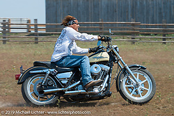 Jay Allen rides his hopped up Harley-Davidson FXR at the Spur Creek Ranch north of Sturgis during a stop for food and cowboy games on the annual Michael Lichter - Sugar Bear Ride hosted by Jay Allen from the Easyriders Saloon during the Sturgis Black Hills Motorcycle Rally. SD, USA. Sunday, August 3, 2014. Photography ©2014 Michael Lichter.