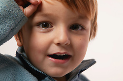 Close up portrait of a toddler smiling,