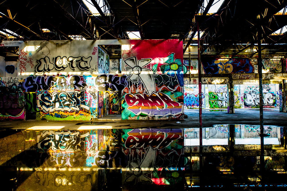 Street artists have painted virtually every wall of this former RC Cola bottling plant in Miami's rapidly developing Wynwood district. <br /> <br /> The building is currently owned by redeveloper and entrepreneur Moise Mana, who sometimes hosts events in it.