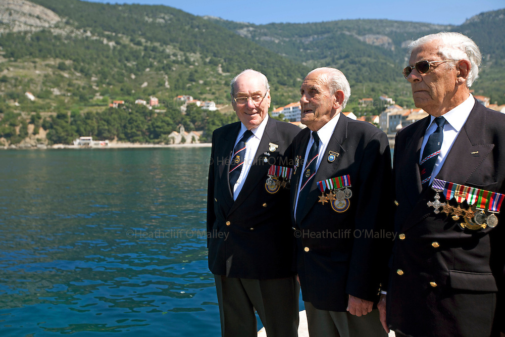 Mcc0031516 . Daily Telegraph..(L to R) Peter Bickmore BEM,Reg Ellis and Flt Lt Freddie Nicoll after Commemorative wreaths are thrown into the Adriatic sea of the jetty in the fishing town of Komiza on the island of Vis where British forces were based during WWII .. A reunion of British WW2 Veterans, probably for the last time. They are some of the last survivors of an Allied combined garrison of Royal Navy, Royal Marine Commandos, Army and Royal Air Force personnel who took over the Island of Vis in 1943 and held it until the end of the War. From here they harried Axis Forces in what was Yugoslavia, providing supply drops to the Partisans and, at one point, refuge for Marshall Tito when he was nearly captured by German Forces ...19 May 2011 Vis, Croatia
