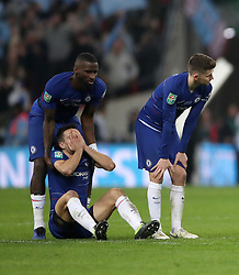 Chelsea's Antonio Rudiger (left), Cesar Azpilicueta (on ground) and Jorginho looks dejected after the Carabao Cup Final at Wembley Stadium, London.