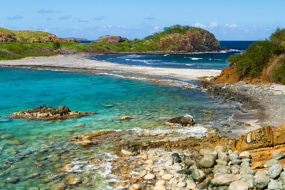"""A ribbon of an isthmus """"separates the Caribbean Sea from the Atlantic Ocean"""" on the far west end of St. Thomas, US Virgin Islands. This is Mermaid's Chair sitting upon Botany Bay."""
