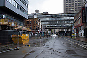Birmingham city centre, which is virtually deserted under Coronavirus lockdown on a wet rainy afternoon on 28th April 2020 in Birmingham, England, United Kingdom. Britains second city has been in a state of redevelopment for some years now, but with many outdated architectural remnants still remaining, on a grey day, the urban landscape appears as if frozen in time. Coronavirus or Covid-19 is a new respiratory illness that has not previously been seen in humans. While much or Europe has been placed into lockdown, the UK government has put in place more stringent rules as part of their long term strategy, and in particular social distancing.