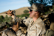 Lt. Long cleans his weapon as the sun sets on the Marines of the 2nd Battalion, 5th Marine Regiment during live-fire exercises at Camp Pendleton.
