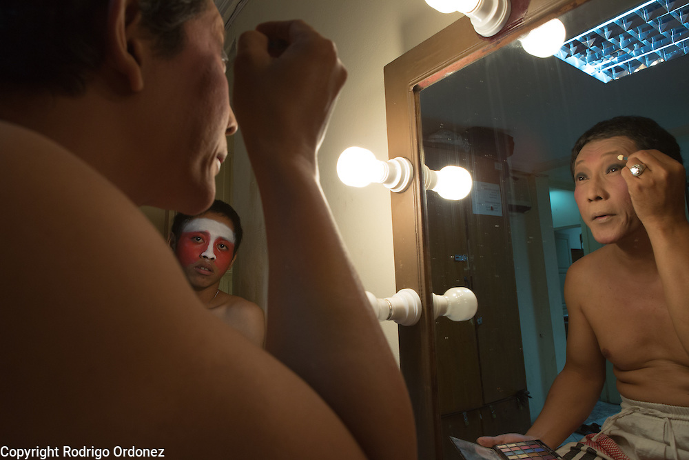 A performer applies make up before a show of 'wayang orang', or 'human puppets', at Bharata Purwa theater in Jakarta, Indonesia.