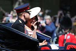 © Licensed to London News Pictures. 09/06/2018. London, UK. The Duke and Duchess of Sussex Prince Harry and Meghan Markle travel down The Mall during the Trooping The Colour ceremony in London to mark the 92nd birthday of Queen Elizabeth II, Britain's longest reigning monarch. Photo credit: Rob Pinney/LNP