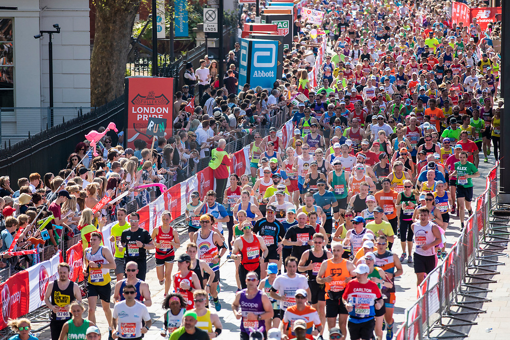 © Licensed to London News Pictures. 22/04/2018. London, UK. Marathon runners pass through Greenwich as they run the Virgin Money London Marathon 2018. Photo credit: Rob Pinney/LNP