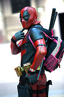 Cosplayer dressed as Deadpool  at the MCM Comic Con at ExCeL exhibition centre in London on October 29, 2017 photo by Roger Alarcon