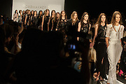 Models on the catwalk at the finale of the BCBGMAXAZRIA show at the Spring 2013 Mercedes Benz Fashion Week show in New York.