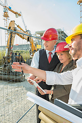 Architect and customers inspecting site