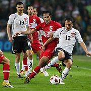 Turkey's Hamit ALTINTOP (C) and Austria's Ekrem DAG (R) during their UEFA EURO 2012 Qualifying round Group A soccer match Turkey betwen Austria at Sukru Saracoglu stadium in Istanbul March 29, 2011. Photo by TURKPIX