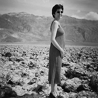 1. When was this photo taken?<br /> <br /> Spring 2001<br /> <br /> 2. Where was this photo taken?<br /> <br /> Death Valley<br /> <br /> 3. Who took this photo?<br /> <br /> Robert Howard<br /> <br /> 4. What are we looking at here?<br /> <br /> This is a photo taken by my brother-in-law of his wife. She is pregnant with their second daughter, which is how I know when the picture was taken. It might have been as early as January 2001 but my niece was born in September, 2001, so I think it must be a spring photo.<br /> <br /> 5. How does this old photo make you feel?<br /> <br /> So, so, so sad. My brother-in-law, his wife, and their two children were killed ten years later. My husband is the executor of their estate, which is how we ended up with the film. It's so hard to see them again as a young family.<br /> <br /> 6. Is this what you expected to see?<br /> <br /> I didn't realize this was film from my brother-in-law's house.<br /> <br /> 7. Does this photo bring back any memories?<br /> <br /> I never went to Death Valley with them but I spent a lot of time with my sister-in-law during this time.<br /> <br /> 8. How do you think others will respond to this photo?<br /> <br /> It is a lovely photo, if you don't know how the story ends.